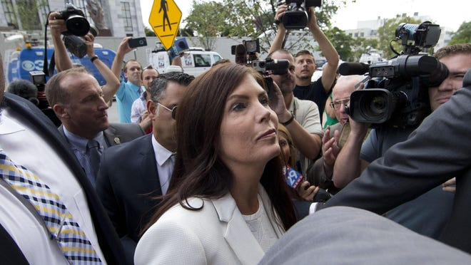 FILE - In this Aug. 8, 2015, file photo, Pennsylvania Attorney General Kathleen Kane arrives to be processed and arraigned at the Montgomery County detective bureau in Norristown, Pa. Kane, a first-term Democrat, is fighting charges she leaked secret grand jury material to a reporter and lied about it under oath. She's also fighting to keep her job _ her law license was suspended, and some lawmakers are trying to remove her using an obscure provision of the state constitution. (AP Photo/Matt Rourke, File)