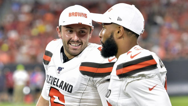 The Browns' Baker Mayfield, left, smiles as he talks with wide receiver Odell Beckham Jr. during a preseason game last season.