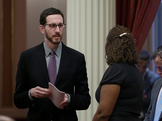 State Sen. Scott Wiener, D-San Francisco, left, talks with Sen. Holly Mitchell, D-Los Angeles, at the Capitol, Thursday, Jan. 26, 2017, in Sacramento, Calif. Wiener, and Sen. Toni Atkins, D-San Diego, introduced legislation on Thursday to add a non-binary gender option on state identifying documents including driver's licenses, birth certificates and identity cards.AP Photo/Rich Pedroncelli)