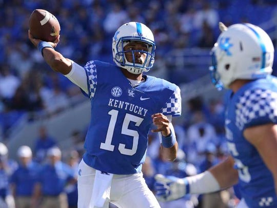 Kentucky Wildcats quarterback Stephen Johnson (15) passes the ball against the Vanderbilt Commodores in the first quarter at Commonwealth Stadium.