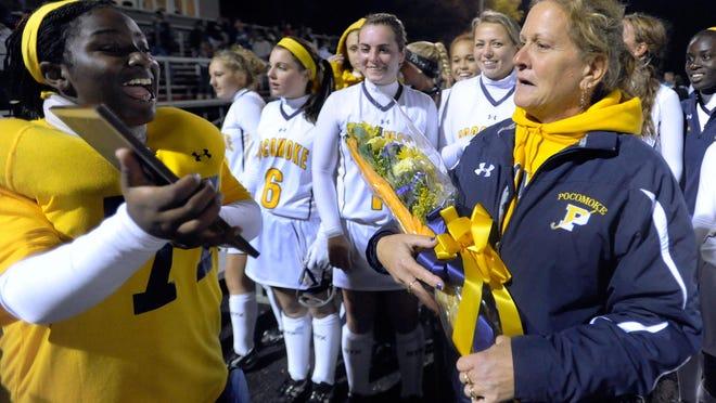 Pocomoke field hockey players, including goalkeeper Jessica Benoit, left, congratulate coach Susan Pusey after winning a Class 1A state semifinal field hockey game against Loch Raven in 2011.
