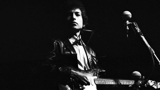 Folk singer Bob Dylan goes electric at the Newport Folk Festival on July 25, 1965, in Newport, Rhode Island.