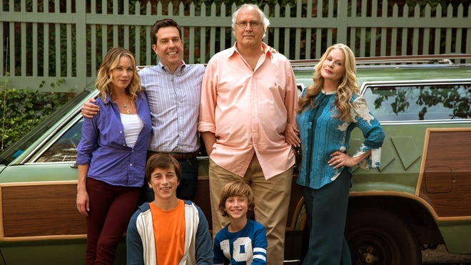 "A new generation of Griswalds is hitting the road., Christina Applegate, standing from left, Ed Helms, Chevy Chase, Beverly D'Angelo, and Skyler Gisondo, kneeling left, and Steele Stebbins appear in a scene from ""Vacation."""