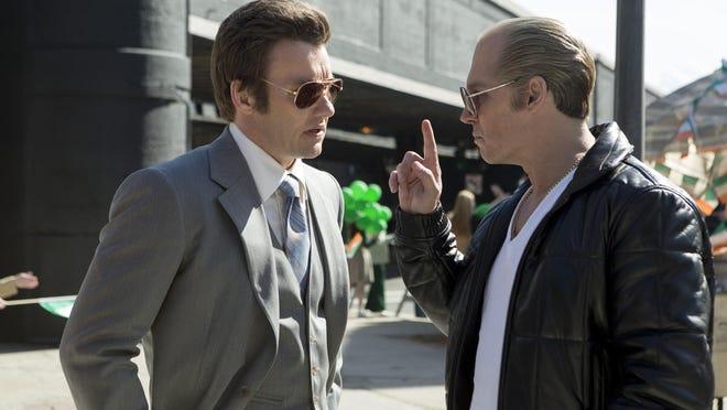 """Joel Edgerton portrays John Connolly, left, and Johnny Depp portrays Whitey Bulger in the Boston-set film """"Black Mass."""""""