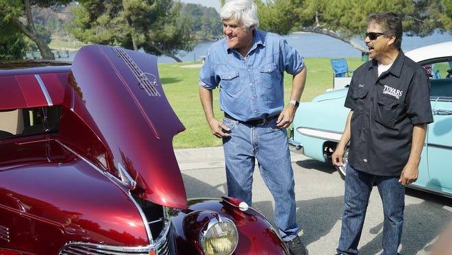 """Jay Leno appears in a scene from """"Jay Leno's Garage."""" After a delay because of the COVID-19 pandemic, the comedian and talk show host will be inducted into the Automotive Hall of Fame this year."""
