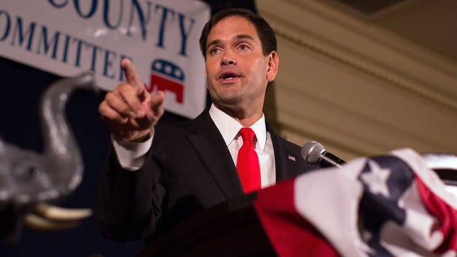 A supporter takes a selfie with Florida Sen. Marco Rubio after his announcement he is running for the Republican nomination, Monday, April 13, 2015, in Miami. (AP Photo/Alan Diaz) ORG XMIT: FLAD107