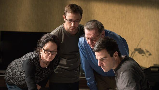 "Melissa Leo, from left, as Laura Poitras, Joseph Gordon-Levitt as Edward Snowden, Tom Wilkinson as Ewen MacAskill and Zachary Quinto as Glenn Greenwald are seen in ""Snowden."""