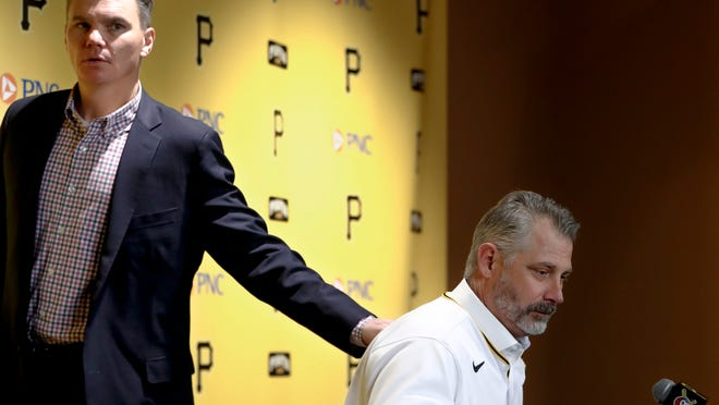 In this file photo from Dec. 4, 2019, general manager Ben Cherington, left, pats Derek Shelton, after a news conference where Shelton was introduced as the new manager of the Pittsburgh Pirates in Pittsburgh. Cherington opted to not make any moves at the trade deadline on Monday. [AP Photo/Keith Srakocic]