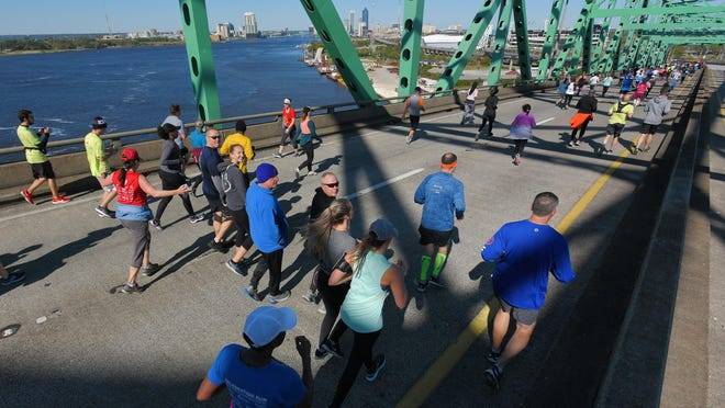 Runners make their way down the back side of the Hart Bridge as they approach the end of their running of the Gate River Run.
