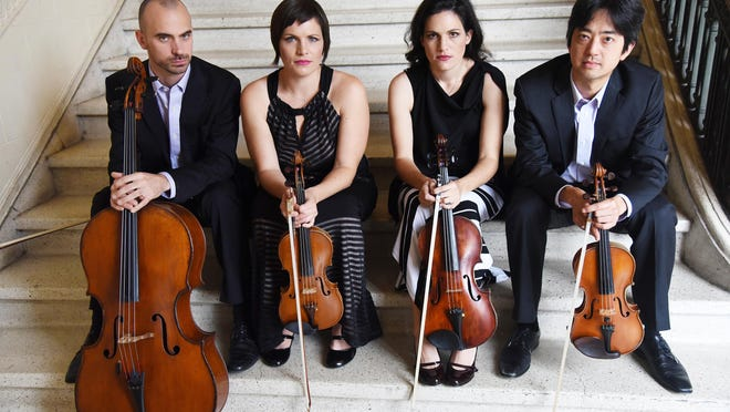 The Jupiter String Quartet -- cellist Daniel McDonough, violinist  Meg Freivogel,  violist Liz Freivogel and violinist Nelson Lee -- entertained a sold-out crown Sunday at The Society of the Four Arts.