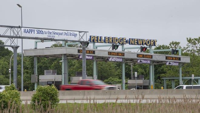 A truck drives through the Newport Pell Bridge toll plaza.