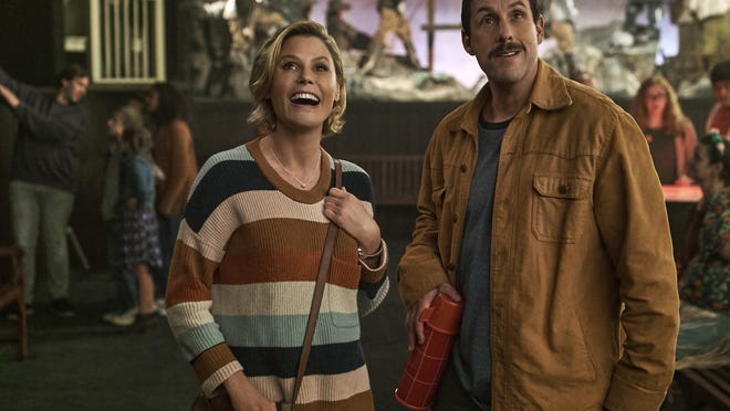 "Julie Bowen, left, and Adam Sandler star in ""Hubie Halloween."""
