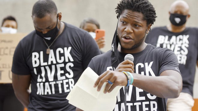 Jacksonville Jaguars NFL football player  Chris Conley addresses the crowd of teammates, staff and families on the steps of the Jacksonville Sheriff's Office headquarters building,  Friday morning, June 5, 2020, in Jacksonville, Fla., as they protest against inequality and police brutality.