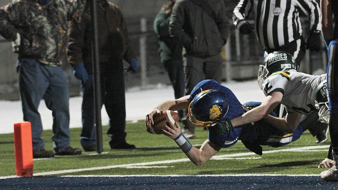 Sam Todd dives for the two-point conversion against Sand Creek on Saturday in the regional finals.