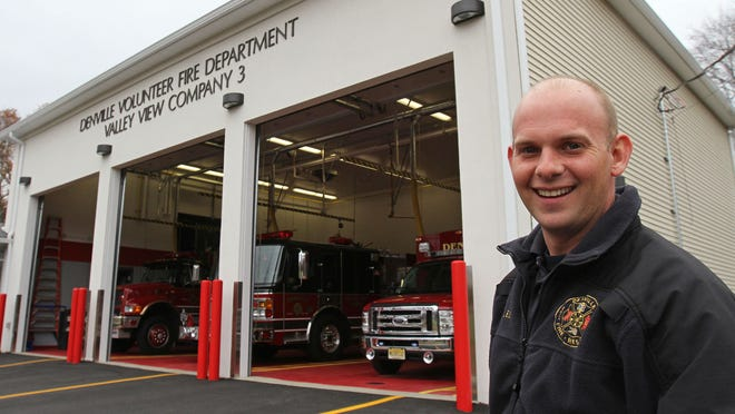 Denville's new fire station, home to Co. 3, will have a ribbon cutting and grand opening on Saturday. Chief Wesley Sharples stands outside the new station. The firehouse was flooded out during Hurricane Irene in 2011.