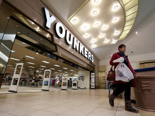A shopper leaves Younkers store Wednesday, Jan. 31,