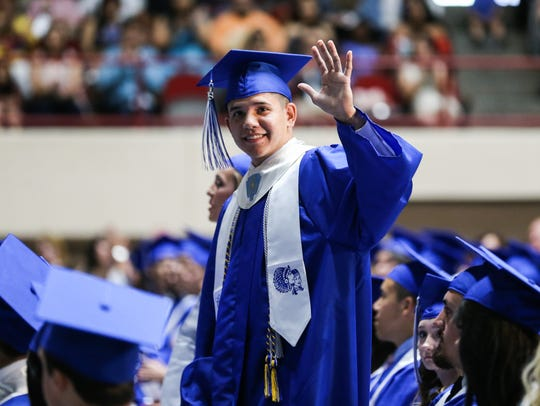 A Lake View student waves at his family during the