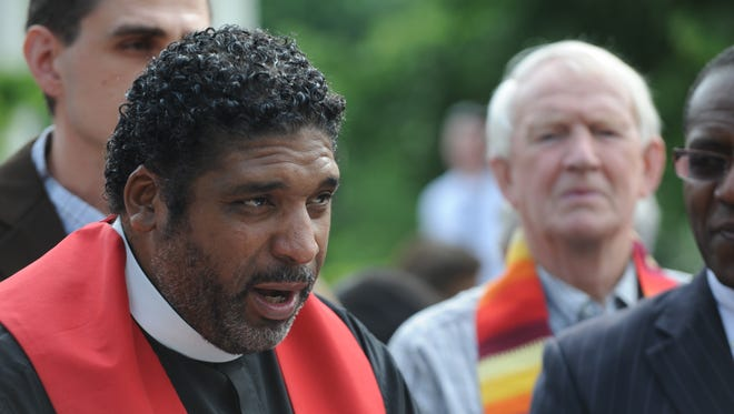 N.C. NAACP President Rev. William Barber speaks out on what he calls state policies that have hurt the poor and public schools on Wednesday, May 14, outside the North Carolina General Assembly head of the legislative short session.
