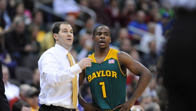 Baylor coach Scott Drew speaks with guard Kenny Chery during a game this season.