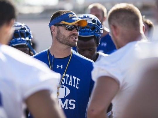 Angelo State coach Will Wagner, center, will coach against his friend Adam Dorrel when the Rams play ACU on Saturday at Wildcat Stadium in Abilene. Wagner and Dorrel coached together at Northwest Missouri State. Saturday's game will be the first time they've coached against each other as head coaches.