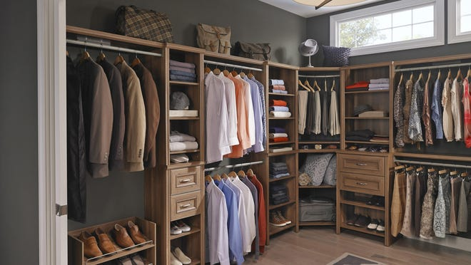 A closet system available at Home Depot offers a mix of hanging space, open shelving and closed storage, perfect for quickly converting a spare room into a dramatic walk-in closet.