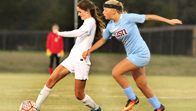 USJ's Sarah Sullivan sends the ball down the field against USN during a Division II-A sub-state match.