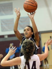 Ellis Middle School point guard Kayla Minchey releases