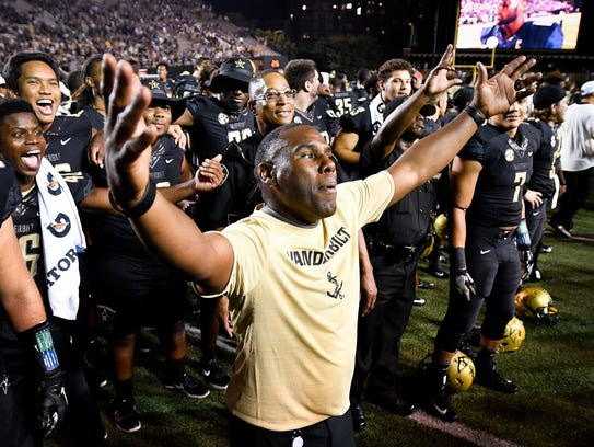Vanderbilt head coach Derek Mason celebrates defeating
