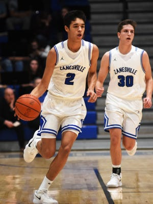 Cameron Brooks-Harris dribbles up court with Coby Curry providing navigation during Zanesville's win over Marietta earlier this season. Brooks-Harris was named the District 12 Division II player of the year.