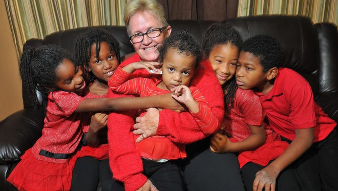 Robin Whiting spends time with her five adopted children. they are Tori, 8, Jenna, 8, Ana, 2, Cayce, 7, and Robie, 11.