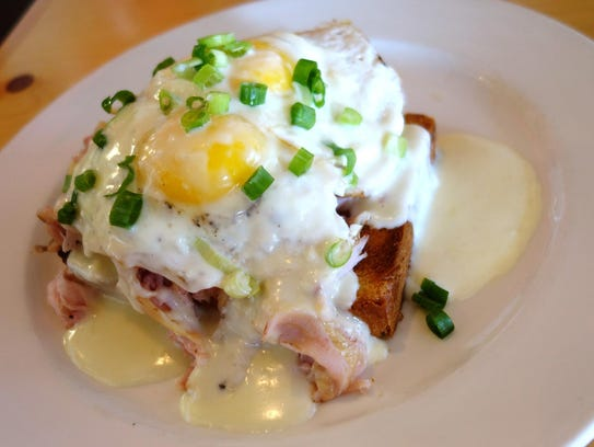 For Sunday brunch, Pig & Pickle makes this open face Croque Madame that's slathered with mornay sauce.