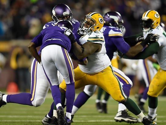 Green Bay Packers defensive tackle Mike Daniels (76)