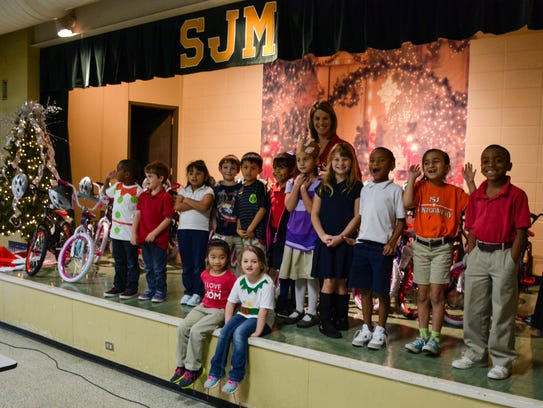 Academy donated 30 bikes and helmets to students at