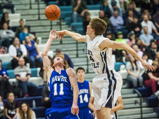 Great Falls' Keaton Burcham hits a ball away from Havre's