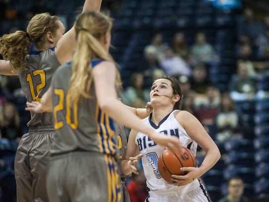 Great Falls' Emma Madsen eyes the basket as she heads