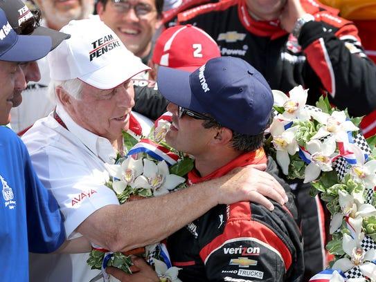 Juan Pablo Montoya, of Team Penske celebrates with