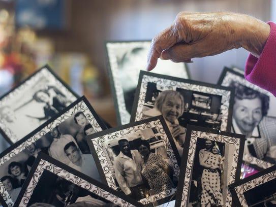 Lillian Sharette identifies family members in photos