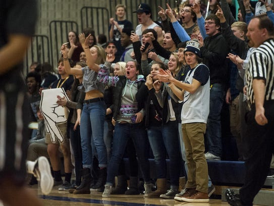The Great Falls High student section cheers as Brendan