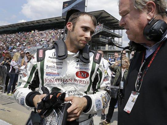 IndyCar driver Bryan Clauson (88) talks with team owner