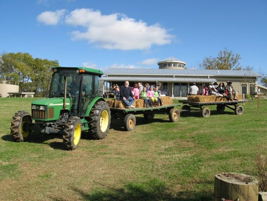 "Past hayride at the annual ""Farm Day"" that has become"