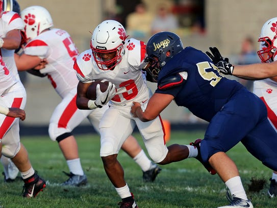 Beechwood running back James Davis runs the ball in