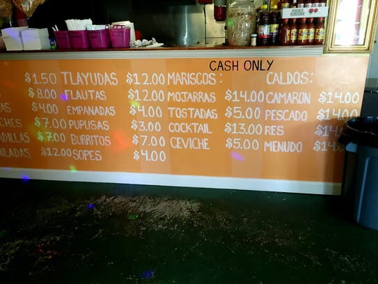The menu is painted under the counter at La Juquilita.