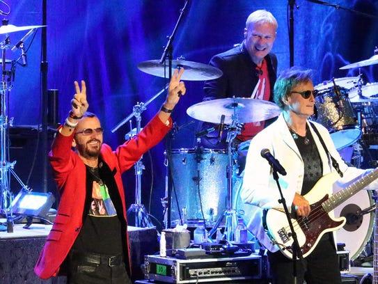 Former Beatles drummer and vocalist Ringo Starr, left,