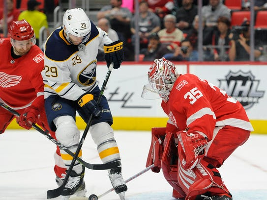Jason Pominville prepares to shoot on Jimmy Howard during the first period Thursday.