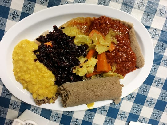 Ajora Ethiopian Kitchen in The Arcade offers vegetarian options, including two kinds of lentils beets, and cabbage, served with the special Ethiopian bread Injera on the side.