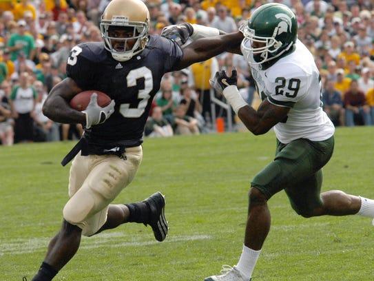 Notre Dame running back Darius Walker (3) gets tackled
