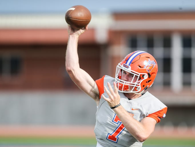 Central's Maverick McIvor practices his throws on the