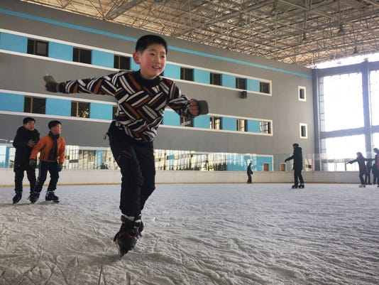 In this Thursday, Feb. 1, 2018, photo, a boy enjoys ice skating at the Outdoor Skating Rink in Pyongyang, North Korea. Though not known as a winter sports power, North Korea will be joining in the Pyeongchang Games set to begin on Feb. 9. (AP Photo/Eric Talmadge)