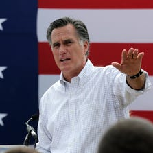 In this July 2, 2014, file photo, Mitt Romney, the former Republican presidential nominee, addresses a crowd of supporters.