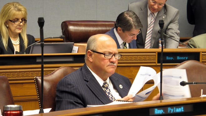 State Rep. Johnny Berthelot, R-Gonzales, reads through details of Gov. John Bel Edwards' budget cut proposal to the House Appropriations Committee, on Tuesday.